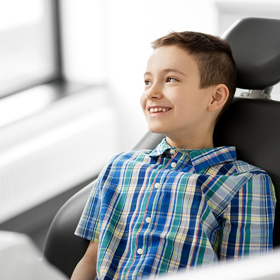 Little boy smiling after pulp therapy