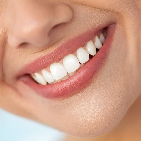 Bright smile after teeth whitening treatment