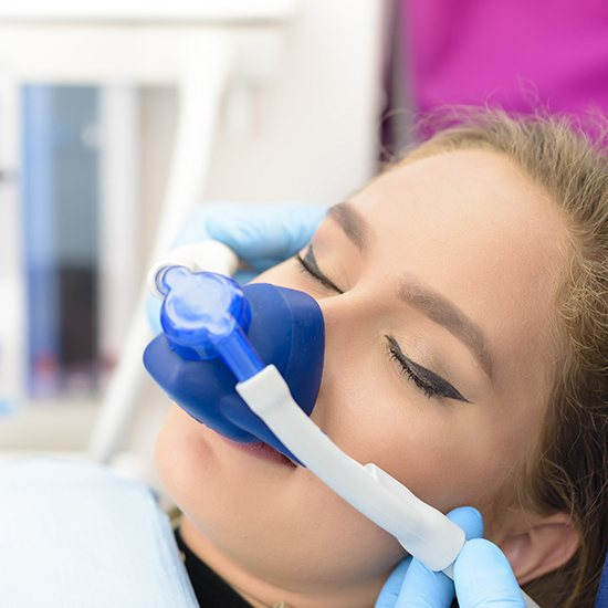 Woman with nitrous oxide sedation dentistry mask